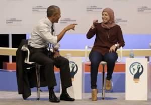 U.S. President Barack Obama speaks with Mai Medhat at the Global Entrepreneurship Summit in Stanford, Calif