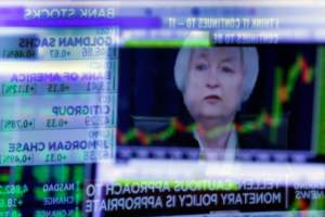 Janet Yellen of the Federal Reserve during a June news conference, as reflected in a specialist's screen on the floor of the New York Stock Exchange. CreditRichard Drew/Associated Press