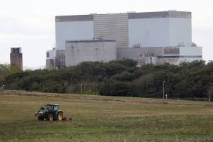 A tractor mows a field on the site where EDF Energy's Hinkley Point C nuclear power station will be constructed in Bridgwater, southwest England October 24, 2013