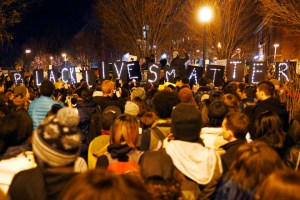 """Demonstrators hold up lighted signs spelling out """"Black Lives Matter"""" during a protest in Boston, Massachusetts, November 25, 2014. Hundreds of protesters marched through Boston one day after Missouri police officer Darren Wilson was not charged for the fatal August shooting of the unarmed black teenager Michael Brown in Ferguson, Missouri. REUTERS/Brian Snyder (UNITED STATES - Tags: CIVIL UNREST CRIME LAW) - RTR4FM1E"""