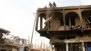 Iraqis inspect a damaged building on October 6, 2015, a day after a blast in a market area in Diyala Province, east of Iraq.