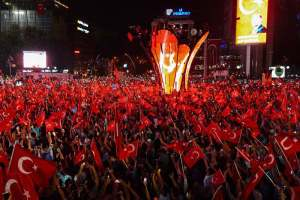 Pro-Erdogan supporters wave Turkish flags at Kizilay square in Ankara on July 18, 2016 during a demonstration in support to the Turkish government following a failed coup attempt.