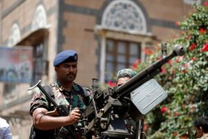 Soldiers hold a machine gun mounted on a police truck outside Yemen's Parliament during a session held by parliament for the first time since the start of the civil war two years ago in Sana'a, August 13.