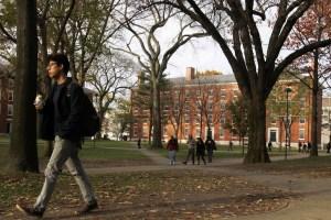 A man walks through Harvard Yard at Harvard University in Cambridge, Massachusetts November 16, 2012. REUTERS/JESSICA RINALDI