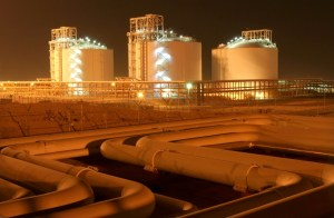 Facilities at phases 2-3 of the South Pars gas field, owned jointly by Iran and Qatar, are illuminated at night in Assaluyeh on Iran's Persian Gulf coast, May 27, 2006. REUTERS/Morteza Nikoubazl