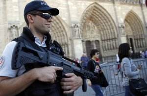 A French police officer patrols in front of Notre Dame cathedral in Paris Friday Sept 9, 2016- AP