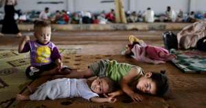 Syrian children lie on the ground while they and others take refuge at the Bab Al-Salameh border crossing, in hopes of entering one of the refugee camps in Turkey, near the Syrian town of Azaz, Aug. 26, 2012. AP