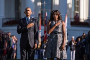 President Barack Obama and First Lady Michelle Obama stand in front of the White House as taps is played on the 4th anniversary of the September 11terrorist attack.-Getty Images