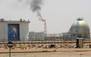 Gas flame is seen in the desert near the Khurais oilfield
