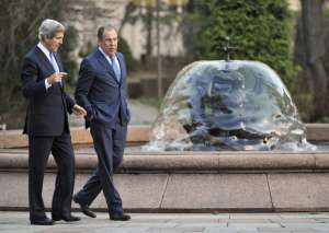 Russia's Foreign Minister Sergei Lavrov, right, and U.S. Secretary of State John Kerry talk during their meeting in Moscow May 7, 2013.