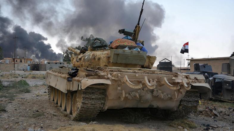 U.S. Soldiers Wear Gas Masks in Qayyara