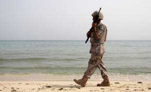 A Saudi border guard patrols near Saudi Arabia's border with Yemen, along a beach on the Red Sea, near Jizan April 8, 2015. REUTERS/Faisal Al Nasser