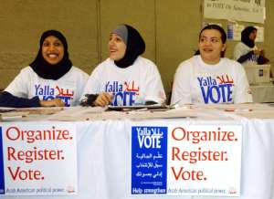 Farhana Quayoum (L), Angel Ouza (C) and Rhima Aoun volunteer at a rally encouraging Arab-Americans to register and vote during this Saturday's democratic presidential caucus, in Dearborn, Michigan February 4, 2004. Arab-Americans across the country have been holding similar registration drives to mobilize political power. - RTXMFJ7