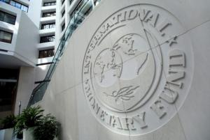 The International Monetary Fund (IMF) logo is seen inside its headquarters at the end of the IMF/World Bank annual meetings in Washington