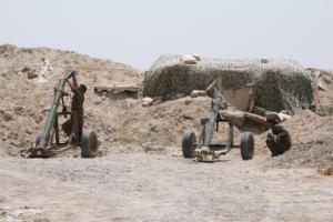 Fighters of the Syria Democratic Forces prepare to fire a mortar shell towards positions held by ISIS fighters in northern province of Raqqa