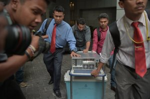 The police raiding the 1MDB office in Malaysia in 2015. The government has said that no 1MDB funds were misappropriated.