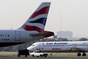 An Iranian Aseman Airlines' Fokker 100 prepares to take off as a British Airways aeroplane is seen in the foreground at Tehran's Mehrabad airport
