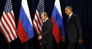 U.S. President Barack Obama and Russian President Vladimir Putin walk into a photo opportunity before their meeting at the United Nations General Assembly in New York