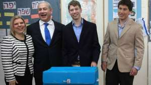 Netanyahu's Family, third wife Sara and sons Yair and Avner, vote in Jerusalem, Jan. 22, 2013.