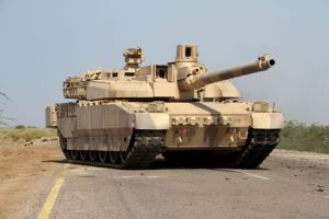 A Yemeni loyalist forces' tank patrols highway in the Red Sea port town of Mocha.