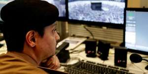 A Saudi security officer monitors live feed screens showing Muslim pilgrims in the holy city of Mecca. AP Photo/Nariman El-Mofty