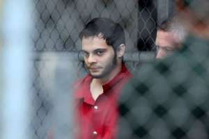 Esteban Santiago is taken from the Broward County main jail as he is transported to the federal courthouse in Fort Lauderdale, Florida, US, January 9, 2017. Reuters