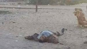 This photo, taken from the site of a militant attack on a checkpoint in the city of al-Arish, shows an unidentified person lying on the ground, Egypt, January 9, 2017.