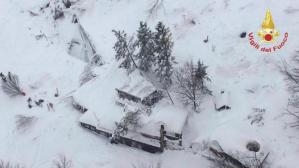 An aerial view shows Hotel Rigopiano in Farindola, central Italy, hit by an avalanche, in this January 19, 2017 handout picture provided by Italy's firefighters. Vigili del Fuoco/Handout via REUTERS
