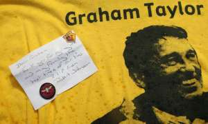 Watford fans pay tribute to Graham Taylor at Vicarage Road. Photograph: Zemanek/BPI/Rex/Shutterstock