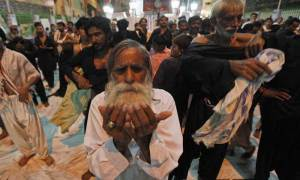 A devotee prays at the shrine of Sufi saint Syed Usman Marwandi, also known as Lal Shahbaz Qalandar, in Sehwan Sharif