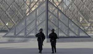French police secure the site near the Louvre Pyramid in Paris, France, February 3, 2017 after a French soldier shot and wounded a man armed with a machete and carrying two bags on his back as he tried to enter the Paris Louvre museum.