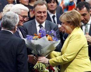 German president-elect, Frank-Walter Steinmeier, receives congratulations by German Chancellor Angela Merkel after the first round of voting of the German presidential election at the Reichstag in Berlin, February 12, 2017.REUTERS/Fabrizio Bensch