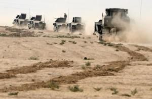 Iraqi special forces soldiers drive in a desert near Mosul, Iraq October 25, 2016.