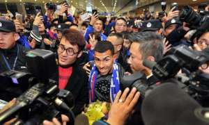 Carlos Tevez is surrounded by fans as he arrives in Shanghai on 19 January 2017. Photograph: Xinhua / Barcroft Images
