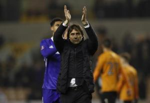 Chelsea manager Antonio Conte applauds fans after the game