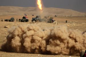 Smoke rises after members of the Iraqi rapid response forces fired a missile towards Islamic State militants during a battle in the south of Mosul