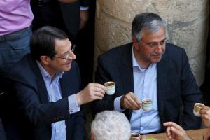 FILE PHOTO: Turkish Cypriot leader Mustafa Akinci (R) and Greek Cypriot leader, Cypriot President Nicos Anastasiades, drink coffee in old Nicosia