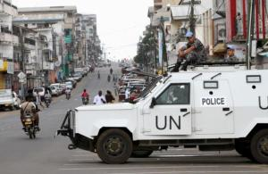 U.N. peacekeepers patrol in their vehicle during Liberia's presidential election run-off, along a street in Monrovia