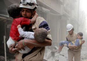Members of the Civil Defense rescue children after what activists said was an air strike by forces loyal to Syria's Bashar Assad in al-Shaar neighborhood of Aleppo, Syria June 2, 2014.