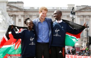 The winners of the London Marathon, Mary Keitany and Wilson Kipsang, both of Kenya, posed with Prince Harry in front of Buckingham Palace on Friday.