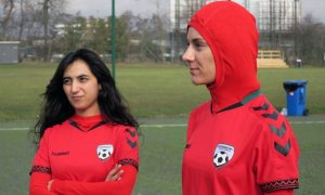 The former Afghanistan captain Khalida Popal with current Afghanistan player Shabnam Mabarz, who is wearing the new head-to-toe outfit with an integrated hijab. Photograph: Jan M. Olsen/AP