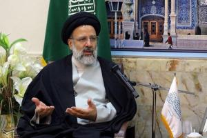 Iranian senior cleric Ebrahim Raisi gestures as he meets grand clerics in the holy city of Qom
