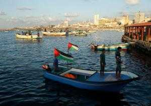 Palestinians stand atop a boat at Gaza seaport in Gaza City.