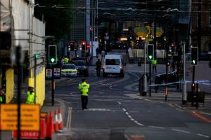 Police patrol the secure area outside the Manchester Arena in central Manchester, Britain