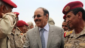 Yemeni Vice President General Ali Mohsen al-Ahmar (C) shakes hands with army officers as he visits military barracks in the eastern city of Marib on August 15, 2016.