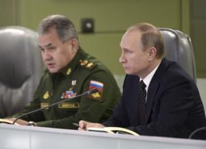 Russian President Putin with Defence Minister Shoigu attend meeting on Russian air force's activity in Syria at national defence control centre in Moscow