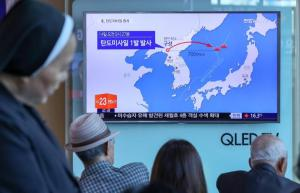 People watch a news report on North Korea firing a ballistic missile, at a railway station in Seoul