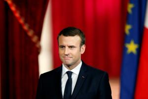French President Emmanuel Macron listens during his inauguration at the handover ceremony at the Elysee Palace in Paris