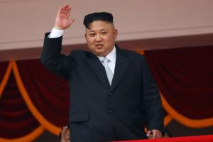 FILE PHOTO: North Korean leader Kim Jong Un waves to people attending a military parade marking the 105th birth anniversary of country's founding father, Kim Il Sung in Pyongyang