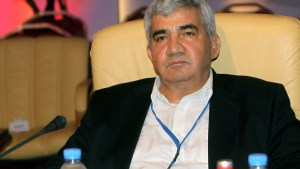Syrian dissident Riad Seif attends a meeting of the Syrian National Coalition for Opposition and Revolutionary Forces, formed after the Syrian National Council (SNC) agreed to the new group, in Doha, Qatar